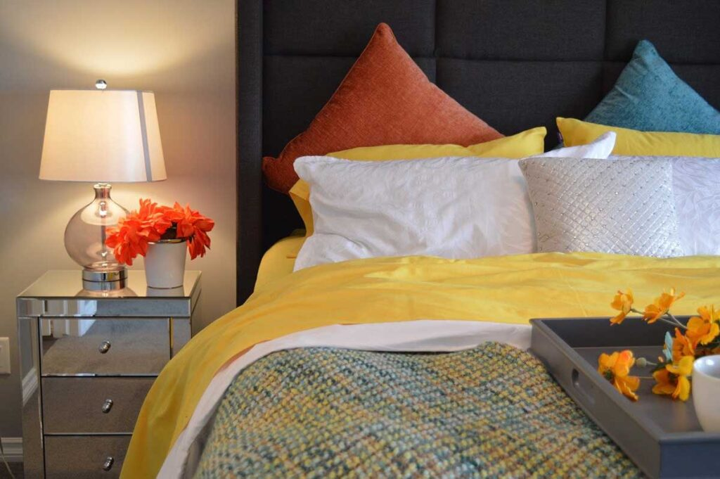 colorful bedroom linens and accent furniture pieces can really customize a space