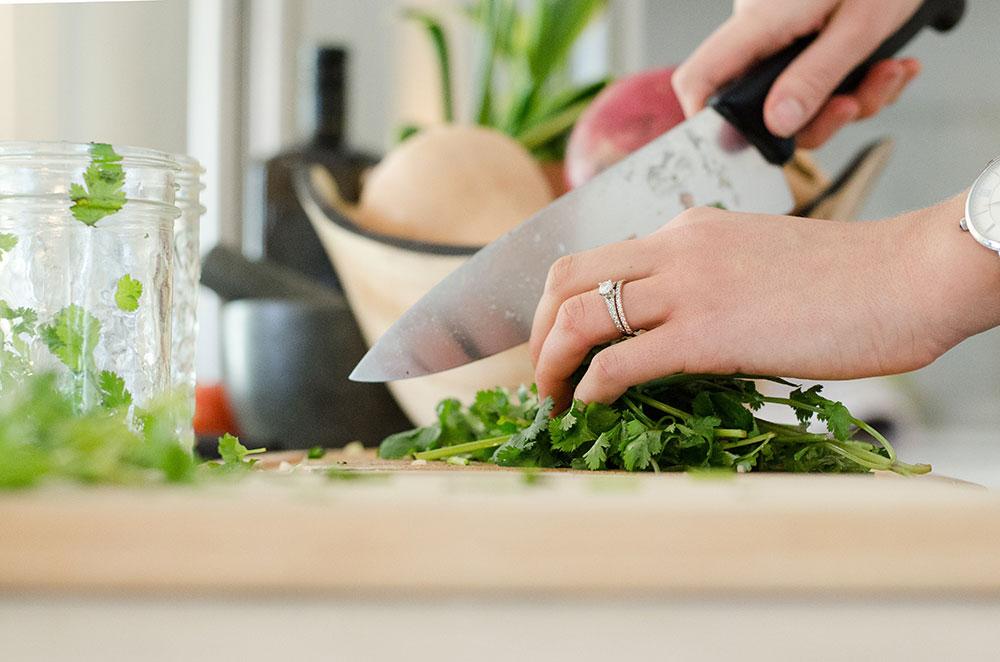 person chopping herbs
